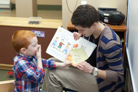 teacher reading to boy